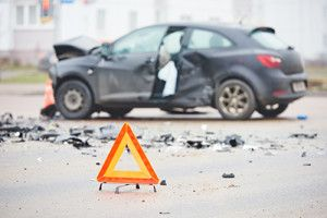 Car Accident with Alert Sign - Car Accidents Can Lead to Bankruptcy