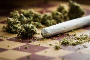 marijuan and a joint on a table | Drugged Driving is Dangerous