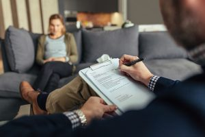 male psychologist with female patient on couch | Therapist Sexual Assault Lawyers
