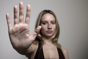 woman holding up here hand in a stop gesture | Workplace Sexual Assault Attorneys