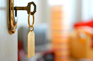 hotel key in a lock | Hotel Sexual Assault Attorney