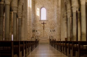 looking down the aisle of a church towards the pew | Church Sexual Abuse Attorneys