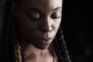 young african-american woman looking solemn | Denver Assault Survivors Law Firm