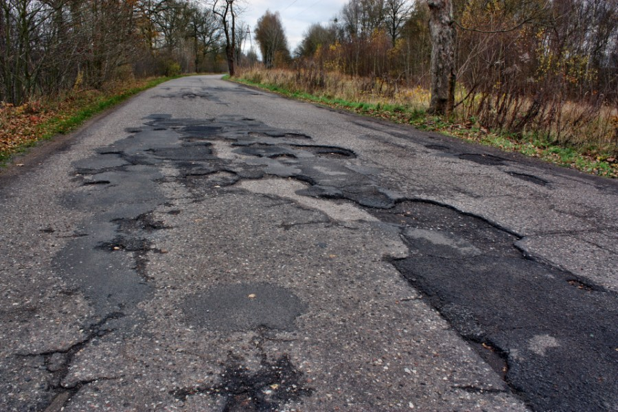 asphalt road in poor condition | poor roads cost colorado drivers $7.1 billion every year