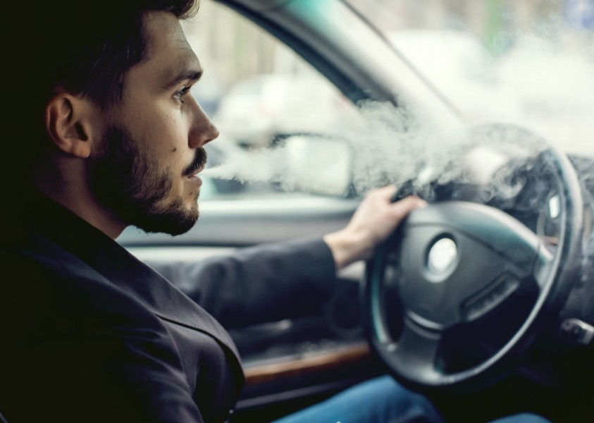 man driving while smoking | high drivers in Denver