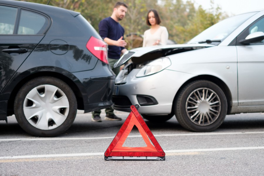 two drivers looking at a rear-end accident | Types of Car Accidents in Denver
