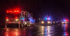 Photo of a police car with firetruck during an accident on a highway | christmas eve rollover accident in lakewood