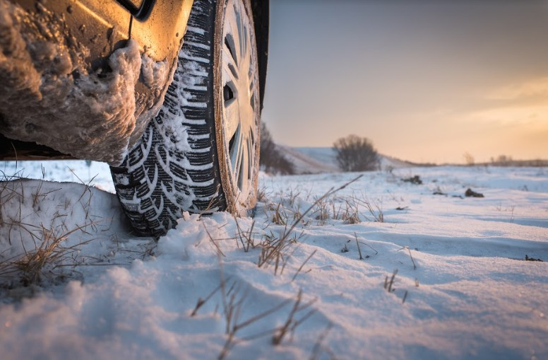 close-up photo of a car's tire on snow | accident on i-70 glenwood springs