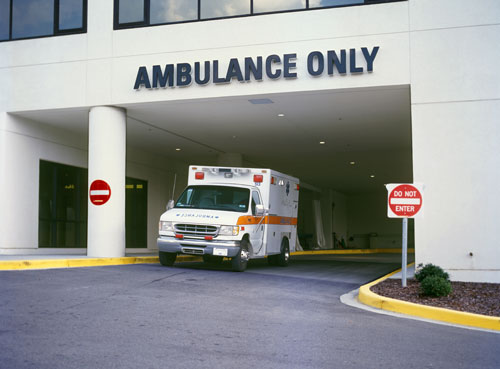 ambulance leaving hospital's emergency exit | single vehicle accident in Grand Junction