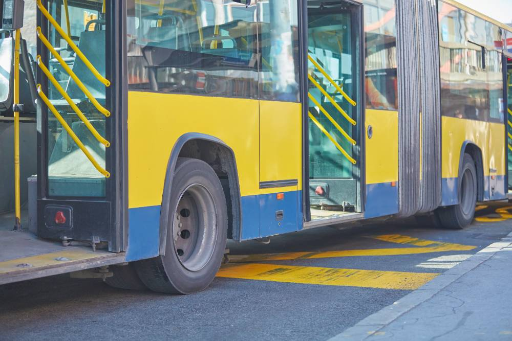 public bus parked in a road with its doors open | pedestrian killed by denver rtd bus