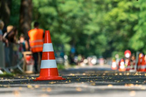 Traffic cone on a street serving as a warning sign | head-on collision on colfax avenue