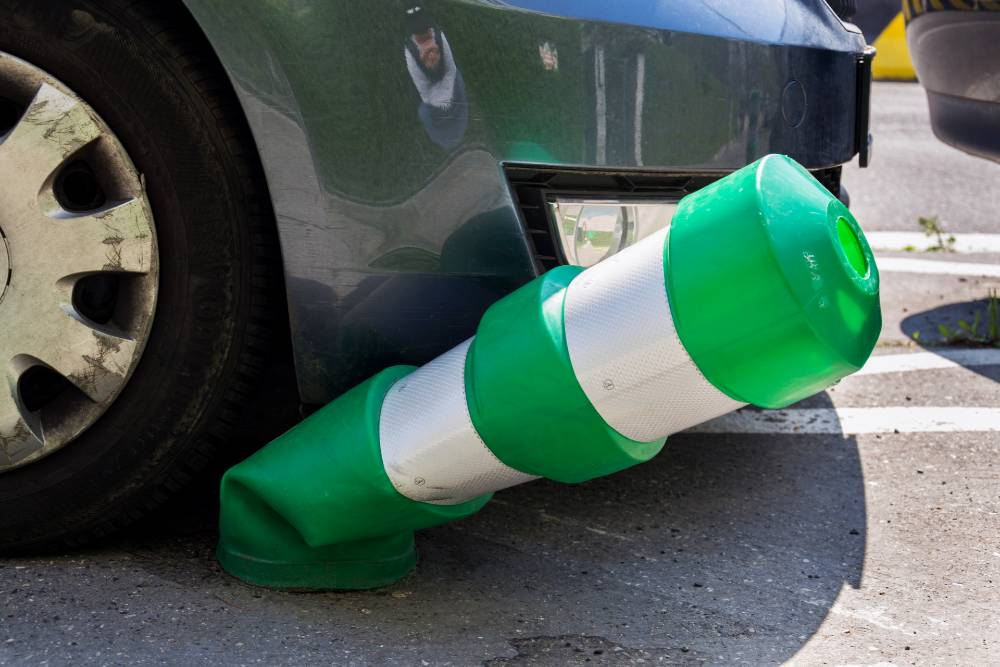 car running over a green safety traffic post | Multi-Vehicle Collision in Fort Collins