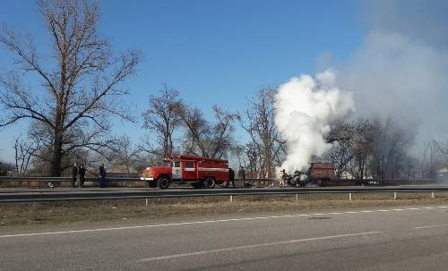 firemen trying to extinguish a burning firetruck on a highway | semi-trailer truck catches fire on i-70