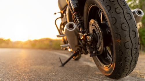 motorcycle parked on the road with a sunny-afternoon background | fatal motorcycle accident in loveland