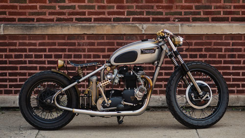 motorcycle against a brick wall