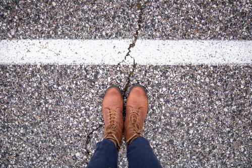 point of view of a woman's shoes standing on a pedestrian lane with a cracked surface | shanna luther fatal pedestrian accident