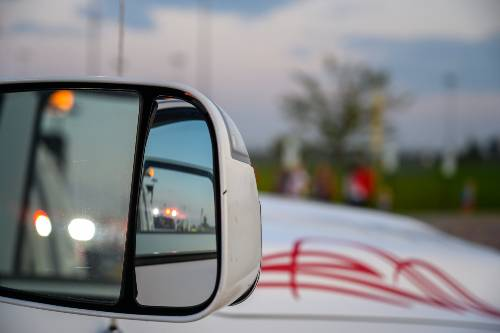 police lights seen from the side mirror of the car | Hit-and-Run Pedestrian Crash on Federal Boulevard
