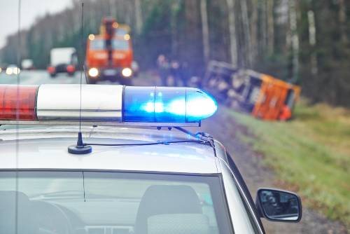 police car parked in front of a lorry accident   mohawk road and woodmen road accident