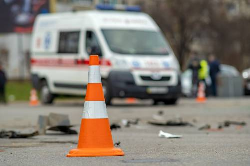 yellow cone placed on the street after a car accident | two brighton sisters injured in car accident