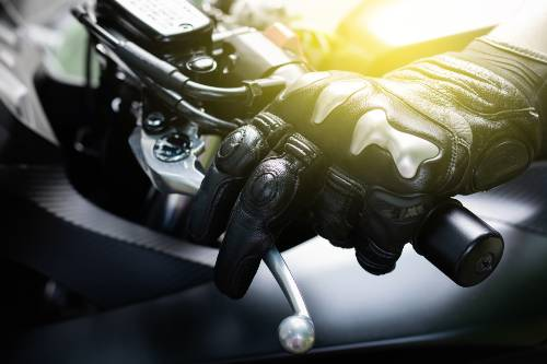 hands wearing black leather gloves gripping a motorcycle cluth | Fatal Motorcycle Collision in Fort Collins