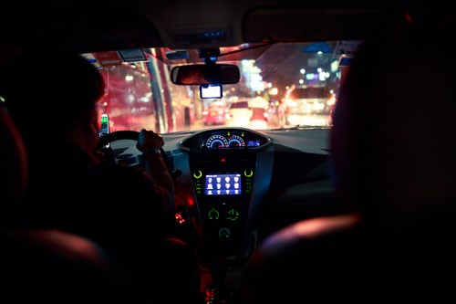 view of the front windshield from the back seat of a taxi at night | Fatal Collision Outside of Pueblo