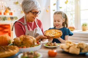 grandma and granddaughter making a pie for thanksgiving
