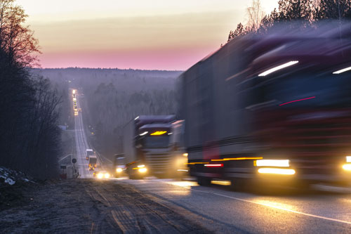 trucks on a highway in an evening | semi-truck vs train collision in Ault