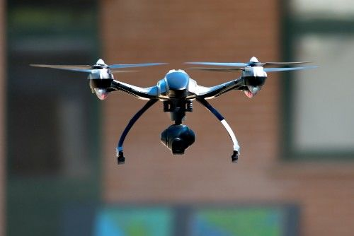drone flying near house | CSP Uses Drones to Process Car Accident Scenes